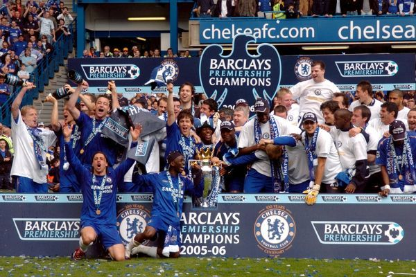 Chelsea players celebrate with the Premiership Trophy
