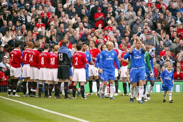 Manchester United players form a guard of honour for the newly crowned Premiership champions Chelsea