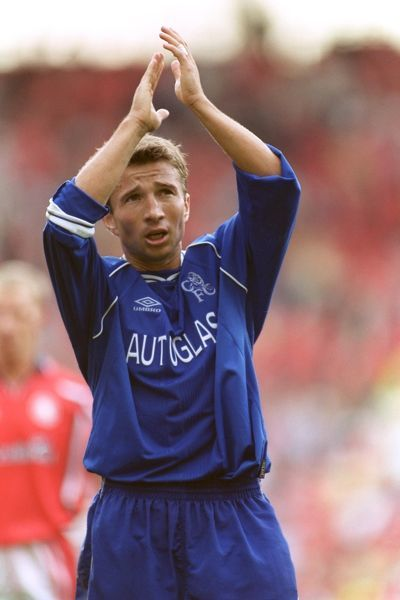 Chelsea's Dan Petrescu applauds their travelling fans