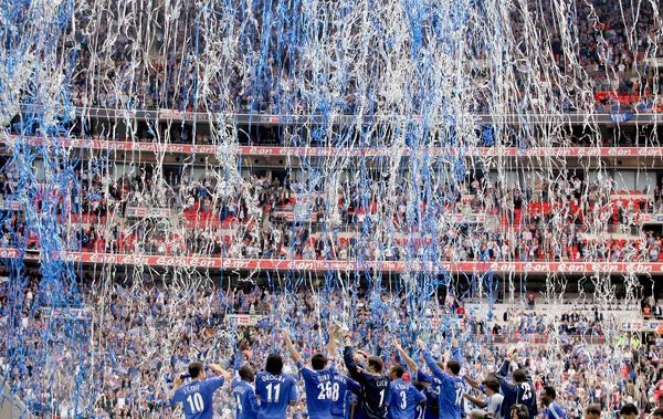 Chelsea players celebrate with the FA Cup Trophy