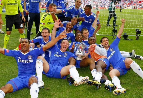 Chelsea players celebrate with the FA Cup trophy after the game