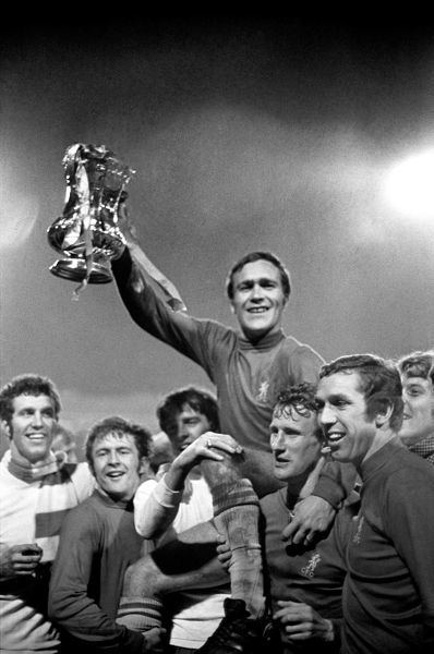 The FA cup is held aloft by Chelsea skipper Ron Harris as he is chaired by team-mates (L-R) Osgood, Hollins, Hutchinson, Houseman and Hinton after the FA Cup Final replay at Old Trafford, Manchester