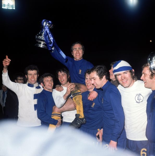 Chelsea's Ron Harris (top) is carried shoulder high by his teammates as he holds the FA Cup aloft: (l-r) Peter Osgood, John Hollins, Ian Hutchinson, Harris, Peter Houseman, Marvin Hinton, Dave Webb, Tommy Baldwin