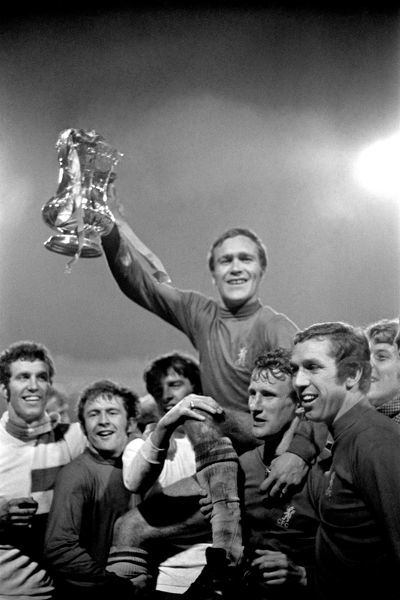 Chelsea captain Ron Harris holds the FA Cup aloft as he is chaired by his triumphant teammates: (l-r) Peter Osgood, John Hollins, Ian Hutchinson, Harris, Peter Houseman, Marvin Hinton