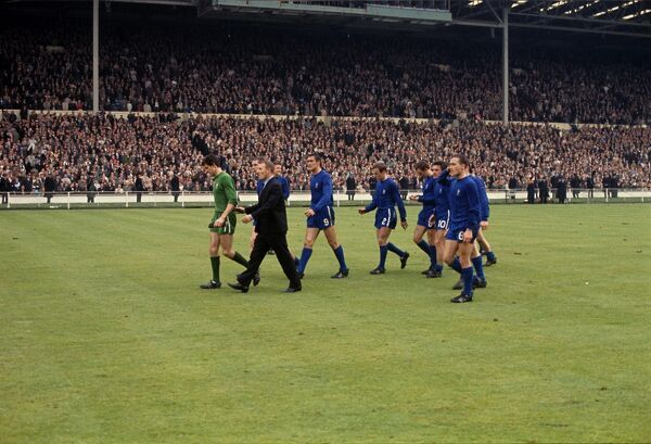 Chelsea manager Tommy Docherty leads his players off the field after defeat