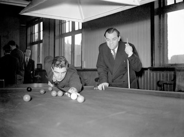 Chelsea's Bobby Smith (l) and trainer Albert Tennant (r) relax with a game of snooker after training