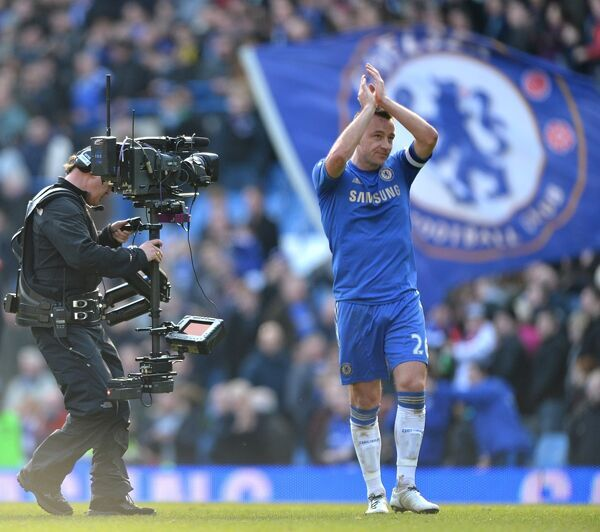 Chelsea's John Terry applauds the fans as he walks off the pitch after the match