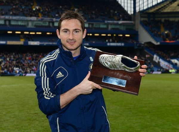 Chelsea's Frank Lampard with a trophy to mark 200 goals for the club