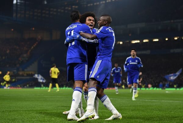 Chelsea's da Silva Willian celebrates scoring his sides first goal of the match with team-mates Didier Drogba and Nascimento Ramires