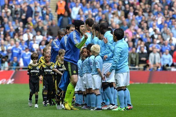 Chelsea and Manchester City players shake hands before the match