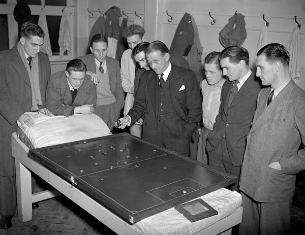 Chelsea manager Billy Birrell gives a tactical talk to some of his players