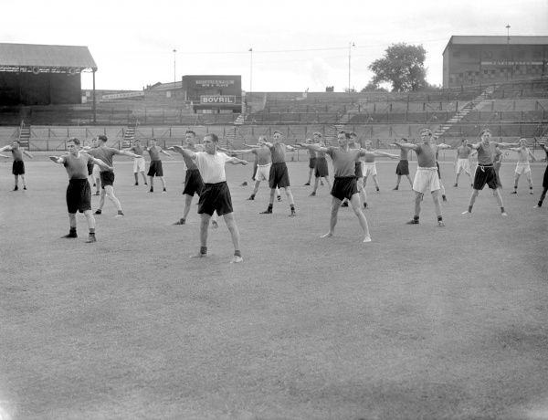 Chelsea players warm up for a training session