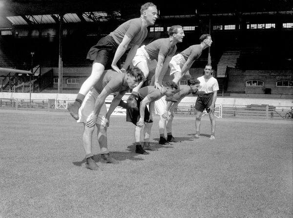 Chelsea players leapfrogging during training