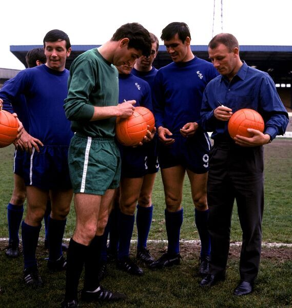 (L-R) Chelsea's John Boyle, Peter Bonetti, Tony Hateley and manager Tommy Docherty sign footballs a week before their appearance in the FA Cup Final