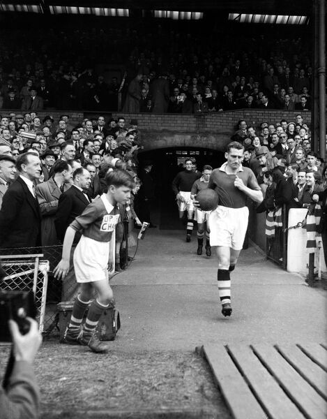 Chelsea captain Roy Bentley leads his team out for their final home match of the season, in which a win would see them clinch the First Division Championship title