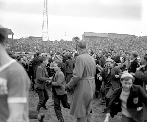 Chelsea's Jimmy Greaves is chaired off the pitch by fans after scoring four goals on his last appearance for the club