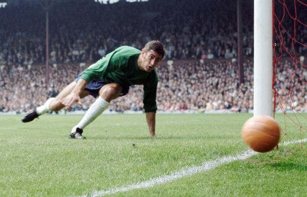 Peter Bonetti, Chelsea goalkeeper, watches the ball pass the post