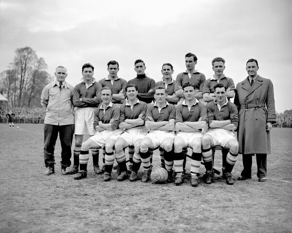 Football League Champions, Chelsea: (back row, l-r) trainer Jack Oxberry, Ken Armstrong, Peter Sillett, Chic Thompson, Stan Willemse, Stan Wicks, Derek Saunders, John Harris; (front row, l-r) Eric Parsons, Jock McNichol, Roy Bentley, Leslie Stubbs