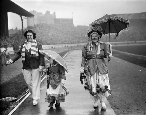Two women and a little girl who are Chelsea football club supporters