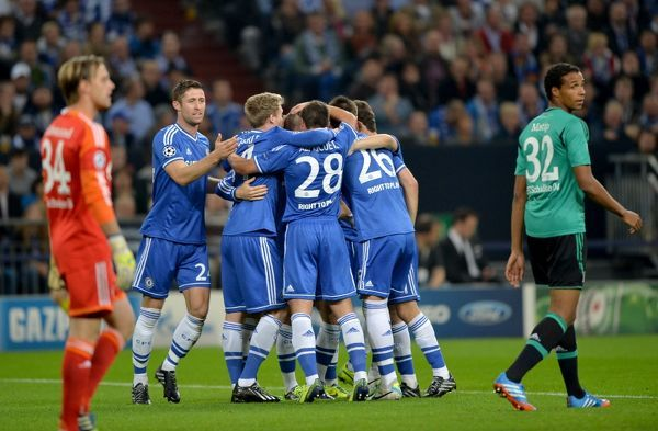 Chelsea's Fernando Torres (obscured) celebrates with team-mates after scoring his team's opening goal