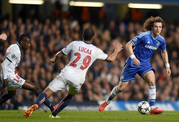 Chelsea's David Luiz runs past PSG's Lucas Moura