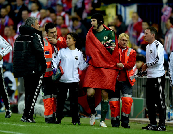 Chelsea's goalkeeper Petr Cech (right) leaves the pitch with an injury with club doctor Eva Carneiro (centre) and manager Jose Mourinho (left)