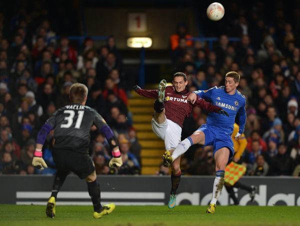 Chelsea's Fernando Torres (right) challenges for the ball