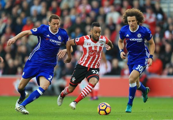 Southampton's Nathan Redmond (centre) battles with Chelsea's Nemanja Matic (left) and David Luiz during the Premier League match at St Mary's Stadium, Southampton