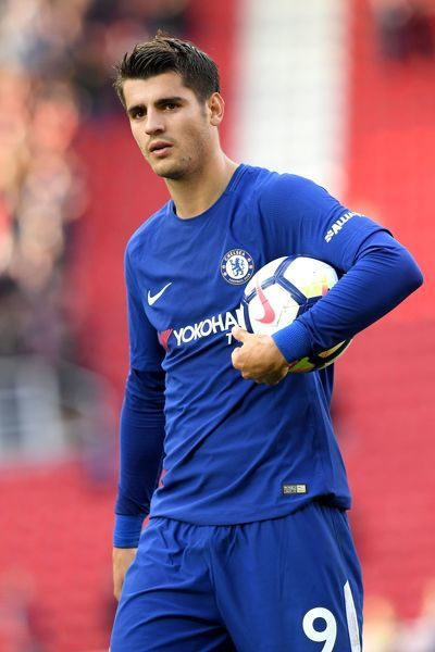 STOKE ON TRENT, ENGLAND - SEPTEMBER 23: Alvaro Morata of Chelsea celebrates his team's 4-0 victory and his hat trick with the match ball after the Premier League match between Stoke City and Chelsea at Bet365 Stadium on September 23, 2017 in Stoke on Trent