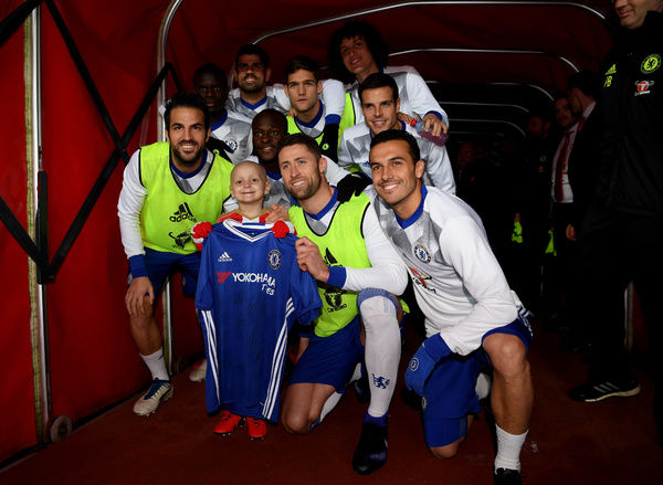 SUNDERLAND, ENGLAND - DECEMBER 14: The Chelsea team pose for a photo with Sunderland fan Bradley Lowrey in the tunnel prior to kick off during the Premier League match between Sunderland and Chelsea at Stadium of Light on December 14, 2016 in Sunderland