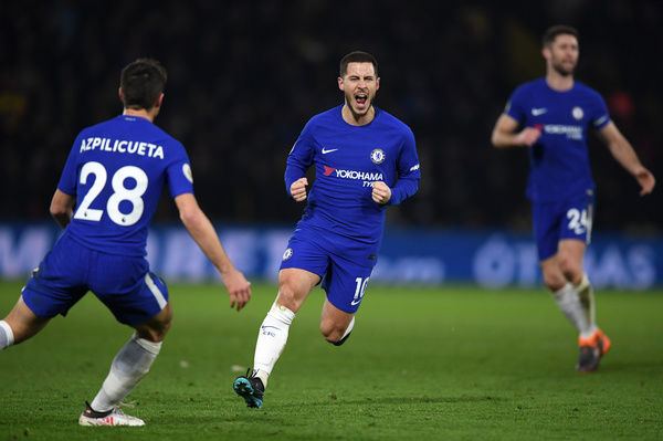 WATFORD, ENGLAND - FEBRUARY 05: Eden Hazard of Chelsea celebrates scoring the first Chelsea goal with Cesar Azpilicueta during the Premier League match between Watford and Chelsea at Vicarage Road on February 5, 2018 in Watford, England