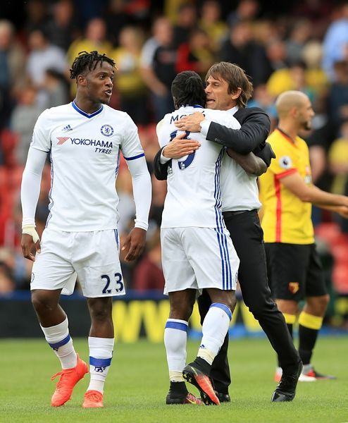 Chelsea's Victor Moses and Manager Antonio Conte celebrate after the final whistle of the Premier League match at Vicarage Road, Watford