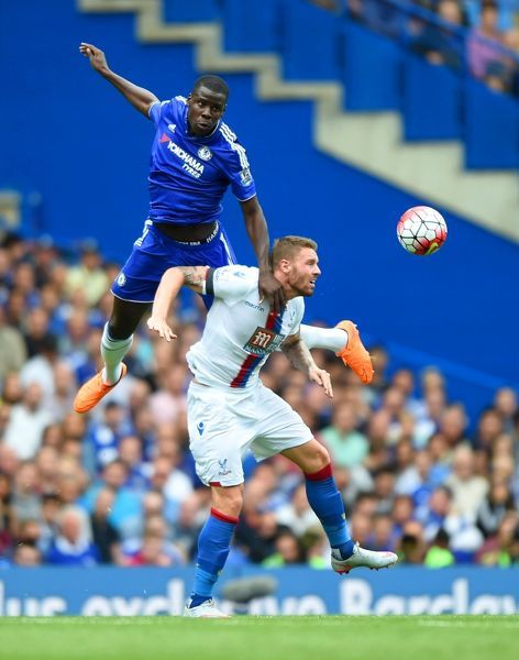 Chelsea's Kurt Zouma and Crystal Palace's Connor Wickham battle for the ball