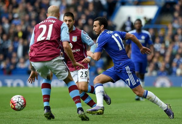 Aston Villa's Allan Hutton, Carles Gill and Chelsea's Pedro battle for the ball