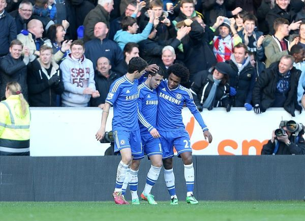 Chelsea's Eden Hazard (centre) celebrates with team-mates after scoring his team's opening goal