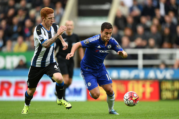 Chelsea's Eden Hazard (right) and Newcastle United's Jack Colback (left) battle for the ball
