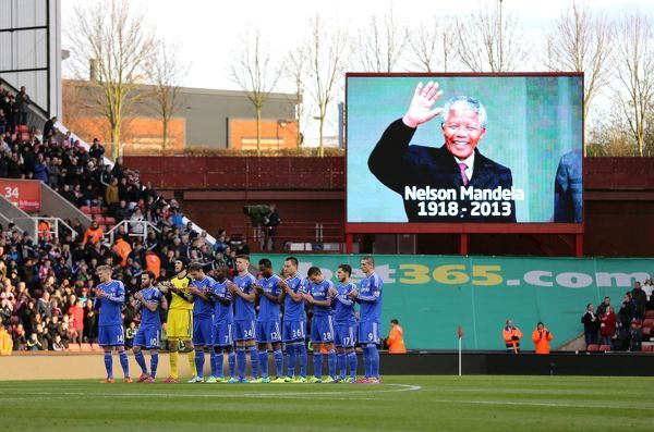 Chelsea players observe a minutes applause for Nelson Mandela during a Barclays Premier League match between Stoke City and Chelsea at the Britannia Stadium on 7th December 2013 in Stoke On Trent, England