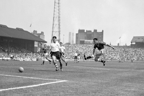 Chelsea's Jimmy Greaves (r) fires in a shot at goal