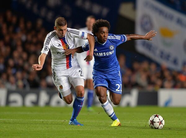 Chelsea's Willian (right) in action with FC Basel's Fabian Frei